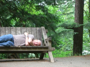 This Is Hard! Man Lying on Bench After Hiking